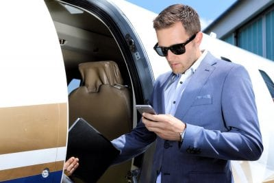 Businessman boarding a private plane